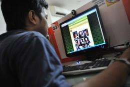 A man browses pictures of Japanese porn star Maria Ozawa on a website