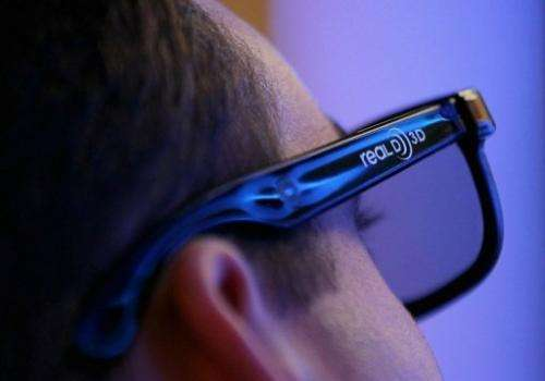 A man wears 3D glasses while watching a demonstration at the Sony booth during a consumer electronics fair in Las Vegas