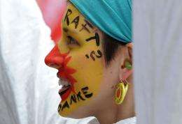 An anti-nuclear demonstrator with her face painted takes part in a protest march in Munich