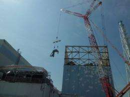 An image from Tokyo Electric Power Co of clean-up work at the Fukushina unit one reactor building