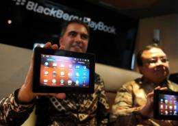 An Official from Research in Motion (RIM) Indonesia displays a BlackBerry playbook in Jakarta
