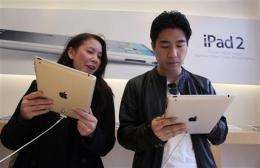 Apple earnings strong, couldn't meet iPad demand (AP)