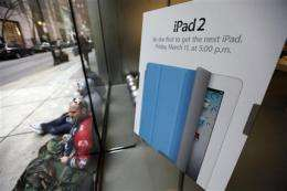 Apple fans line up to buy first batch of iPad 2s (AP)