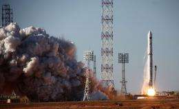 A rocket carrying the Spektr-R space telescope blasts off from Baikonur cosmodrome
