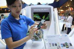 A Samsung marketing promoter demonstrates one of the new smartpones powered by Google's Android operating system