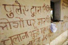 "A slogan in Hindi on a wall in Tundi, in India's Jharkand state, says: ""Stop police harassment"""