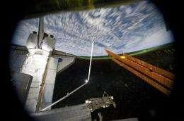 Astronauts load storage bin on last space shuttle (AP)