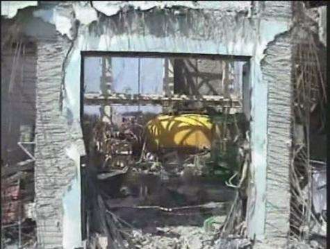 A video image taken by a TEPCO drone showing the top part of the nuclear reactor containment vessel