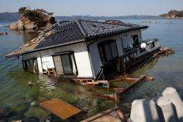 A washed up house stands on the shoreline in Onagawa, Miyagi prefecture in April