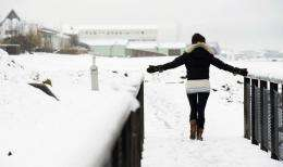 A woman stands in the snow in the center of Reykjavik