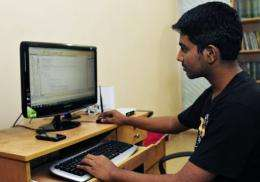 Bangladeshi computer programmer Abdullah Al Zahid works on his computer at his house in Dhaka