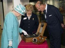 Britain's Queen Elizabeth II (left) starts the wartime Enigma codebreaking machine at Bletchley Park in July