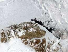 Broken ice floats in the Arctic Ocean off the northern coast of Greenland in 2004