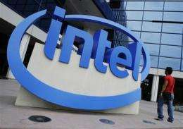Business buying lifts Intel as tablet threat looms (AP)