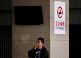 China renews push to ban smoking starting May 1 (AP)