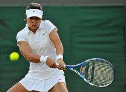 China's Li Na returns a shot at the 2011 Wimbledon Tennis Championships