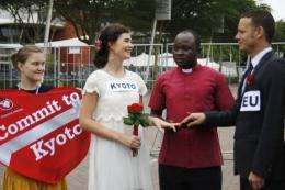 Christian Aid supporters stage a mock ceremony in Durban to support an extension of the Kyoto climate change protocol