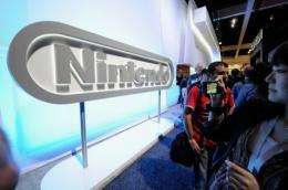 Crowds line up to see the new Nintendo game console Wii U at the Nintendo booth during the Electronic Entertainment Expo