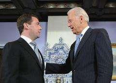 Dmitry Medvedev (L) talks with Joe Biden