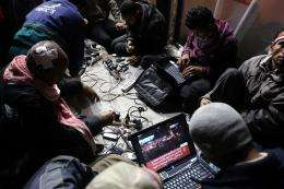 Egyptian anti-government bloggers work on their laptops from Cairo's Tahrir square in February