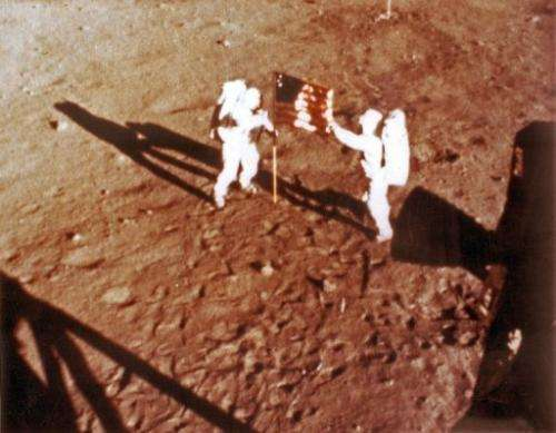 """File photo shows US astronauts Neil Armstrong and """"Buzz"""" Aldrin deploying the US flag on the moon on July 20, 1969"""