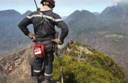 Firemen working at the Cirque de Mafate on the French overseas island of La Reunion
