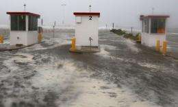 Heavy surf from Hurricane Irene enters the beach parking lot in Ocean City, Maryland