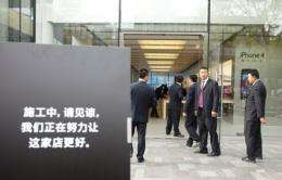 Lines for the popular iPad 2 in Beijing have grown so long that people have begun selling their places in the queue