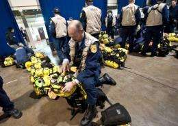 Members of the Fairfax County Search and Rescue team prepare their equipment at Misawa Air Base, in northern Japan