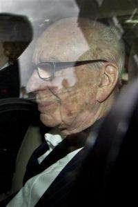 Murdoch pressured to testify in phone hack inquiry (AP)