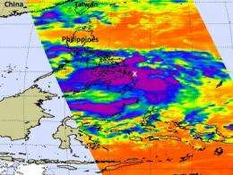 NASA sees large Tropical Storm Banyan stretched over southern Philippines