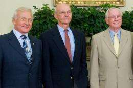 "Neil Armstrong (R), and fellow Apollo 11 crewmembers Edwin ""Buzz"" Aldrin (L) and Michael Collins (C)"