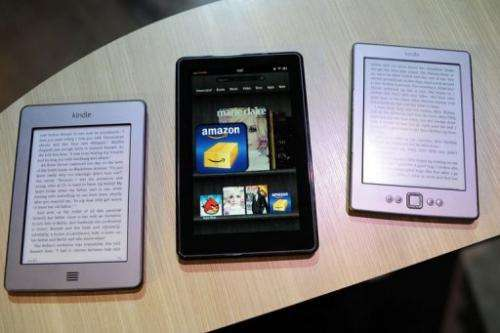 New Amazon Kindle products Kindle Touch (L), Kindle Fire tablet (C) and new Kindle