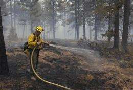 NM fire poised to become largest in state history (AP)
