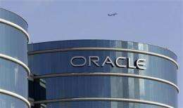 Oracle's net rises 36 percent, but servers slip (AP)