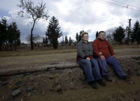 Pal (right) and Piroska Nyoma sit where their house once stood in Devecser