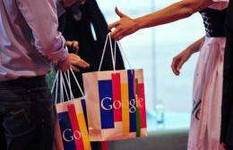 Patrons hold bags showing the Google logo