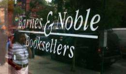 People walk by a Barnes & Noble store in New York