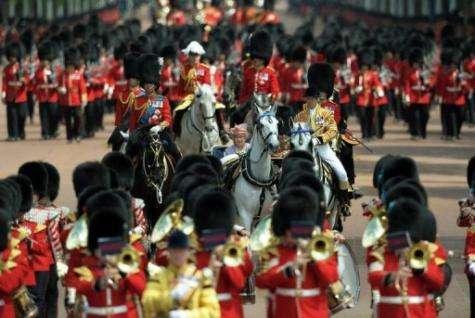 Queen Elizabeth II (C) and her husband Prince Phillip, The Duke of Edinburgh ride to Buckingham Palace