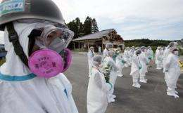 Residents pray for the earthquake and tsunami victims near the TEPCO Fukushima nuclear power plant
