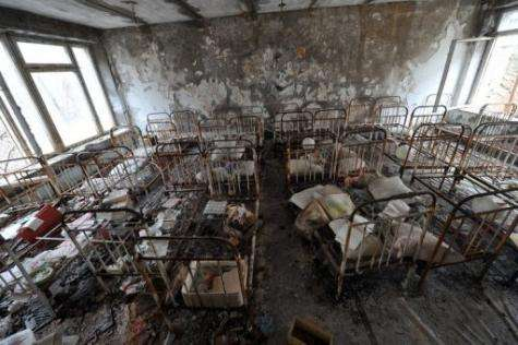Rusted wrought-iron bed's are pictured in a kindergarden in the ghost city of Pripyat, a few kilometres from Chernobyl