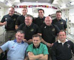 Shuttle astronauts bid farewell to space station (AP)