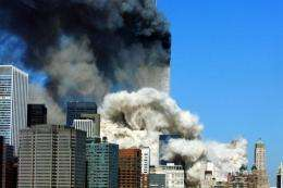 Smoke billows up after the first of the two towers of the World Trade Center collapses
