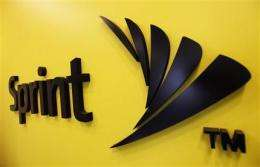 Sprint adds 1.1M subscribers, halves 1Q loss (AP)