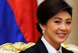 Thai Prime Minister Yingluck Shinawatra was criticised in eight tweets on her own Twitter account