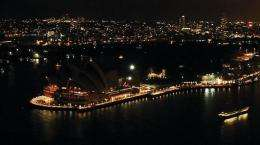 "The lights around Sydney's Harbour and the iconic Opera House (L) turned off to mark ""Earth Hour"""