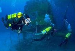 This undated file image obtained in 2003 shows divers entering the Aquarius underwater habitat