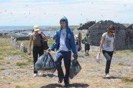 Uruguayan high school students pick up trash at Flores Island