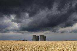 View of the four cooling towers of Temelin Nuclear Power Plant behind a grain field in the village of Temelin