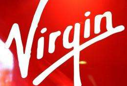 Virgin Media said it had agreed a deal with Sweden's Spotify to offer music streaming services